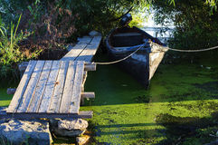 Wood pontoon and traditional boat Royalty Free Stock Photos