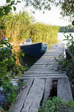 Wood pontoon and traditional boat Royalty Free Stock Image