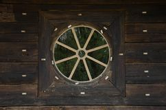 Wood porthole. A small exterior window in a ship or aircraft Stock Image