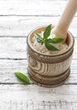 Wood pounder with salt and basil Stock Photography