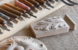 Wood processing. Joinery work. wood carving. the carving object with pattern, chisels for carving close up. small depth of field.