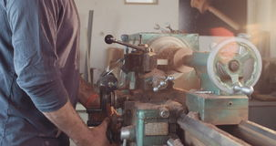 Wood processing on a lathe stock video