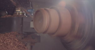 Wood processing on a lathe stock video footage