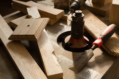 Wood products and tools lie on a workbench in a workshop Stock Images