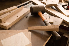 Wood products and tools lie on a workbench in a workshop Stock Photography
