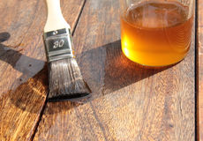 Wood protection. By flaxseed oil in the outside area Stock Photos
