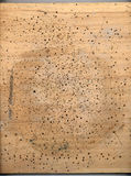 Wood, punctured. An old piece of wood, used as a working surface royalty free stock photo