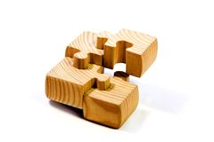 Wood puzzle. Deconstucted with four pieces, one over another Stock Image