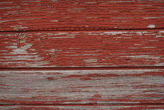 Wood röd texturväggyttersida - Arkivfoto
