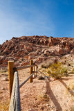 Wood Rail Fence Into Desert Toward Mountains Stock Photography