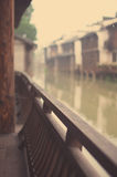 Wood railing. Wuzhen river on both sides there are many such railing made of wood, can be casual sitting doing nothing, in a daze looking at the royalty free stock photography