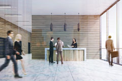 Wood reception, marble floor, front, people Royalty Free Stock Photography