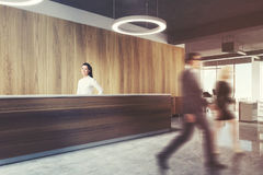 Wood reception in round lamp office, side view men Royalty Free Stock Photography