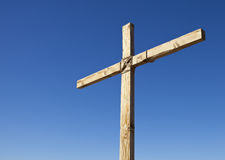 Wood Religious Cross. Wooden Cross on Blue Sky Background Stock Photography