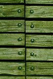 Wood with rivets Stock Images