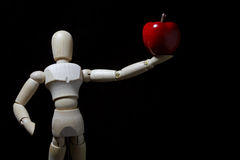 Wood robot and  mini   apple in action . Stock Photo