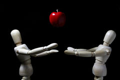 Wood robot and  mini   apple in action . Royalty Free Stock Photo