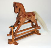 Wood Rocking Horse. Small decorative wood rocking horse at an angle Royalty Free Stock Photography
