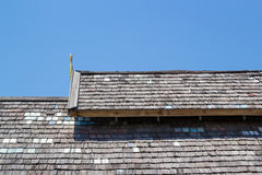 Wood roofing pattern detail. On blue sky background Royalty Free Stock Photography