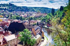 Wood and roofs of houses of Medieval city Cesky Krumlov and the Vltava River stock photography