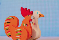 A wood rooster and goose toy- childhood time.  royalty free stock photos