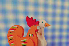 A wood rooster and goose toy - childhood time.  royalty free stock photo