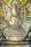 Wood and rope bridge Stock Images