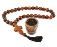 Wood rosary and ancient glass. Isolated on a white background Stock Photography