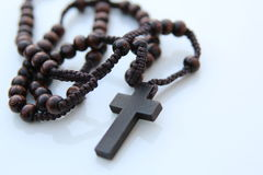 Wood rosary and cross Stock Images
