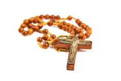 Wood rosary and cross with slightly unfocused Stock Photos