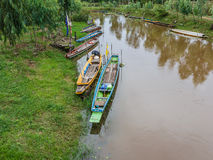 Wood rowboat on canal in Thailand Stock Images
