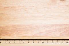 Wood ruler. On wood background Stock Photography