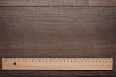 Wood ruler on the wooden background Royalty Free Stock Photos