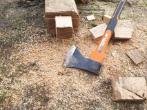 Wood and sawdust. Ax, wood and sawdust lying on the ground Stock Photo