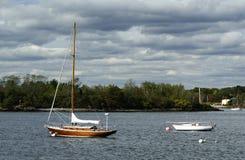 Wood Sailboat. A wood sail boat moored at the ocean Stock Photo