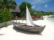 Wood sailing boat on beach. Wood sailing boat is a kind of fisher boat in Maldives Stock Photos