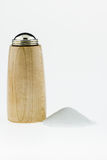 Wood salt Shaker with salt pile on a white background. Royalty Free Stock Photo