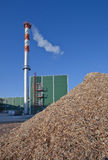 Wood sawdust and a factory pipe Royalty Free Stock Photo