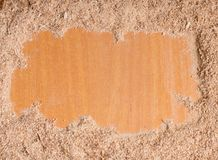 Wood sawdust on wooden background with free copy space. Empty space for text with sawdust. royalty free stock images