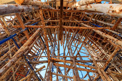 Wood scaffolding in the construction site Stock Image