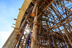 Wood scaffolding in the construction site stock images