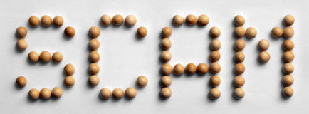 Wood Scam för ` för halsordkonst `, arkivfoto