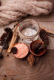 Wood scents for winter time aromatherapy. Pine cones, candles, essential oil bottles, top view. Spa relax winter concept, copy. Space royalty free stock photo