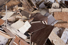 Wood scrap. A pile of different types of processed wood pieces ready to go to a dump for construction materials Stock Images