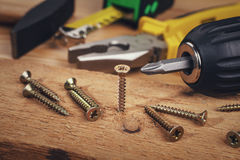 Free Wood Screws And Carpentry Tools Royalty Free Stock Photos - 76510688