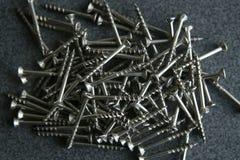 Wood screws background. Wood screws texture top view Stock Photo