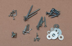 Wood screws, bolts, washers, nails, laid out in pi Stock Photography