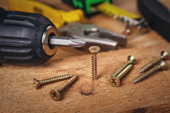 Wood screws and carpentry tools Royalty Free Stock Image