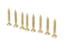 Wood Screws in Row. Wood screws in a row isolated on a white background Royalty Free Stock Photos