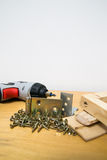 Wood and screws. Screwdriver, wood parts and screws Royalty Free Stock Photo